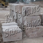 how to build a grade sandstone block wall
